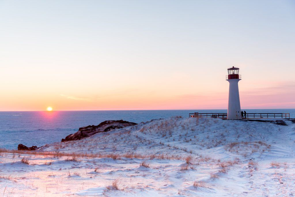 Lighthouse in the Magdalen Islands at sunset.